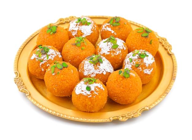 Indian sweet food motichoor laddu or bundi laddu isolated on white background Premium Photo