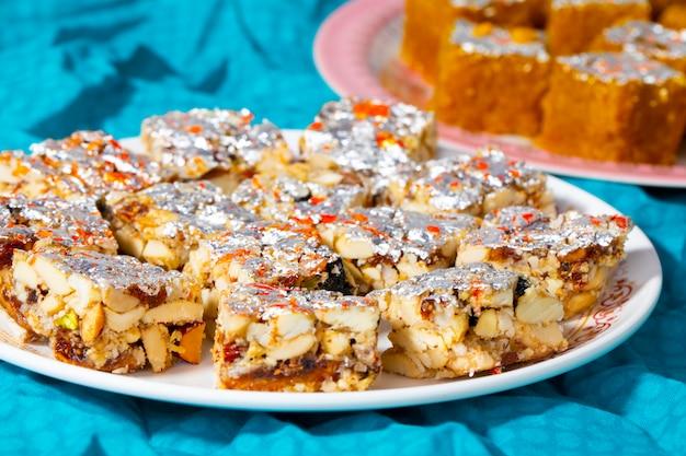 Indian sweet food sugar free dry fruits with mung dal chakki Premium Photo