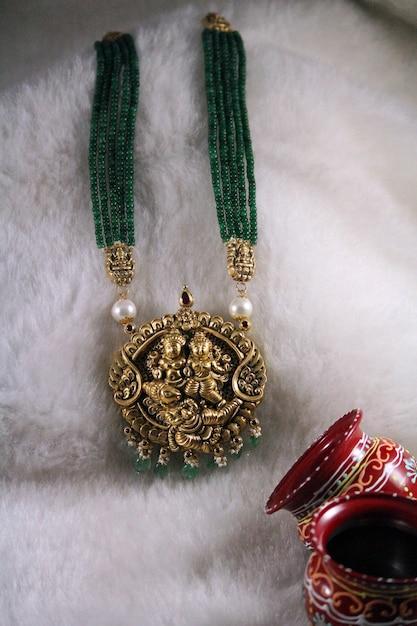 Indian temple jewellery gold Premium Photo