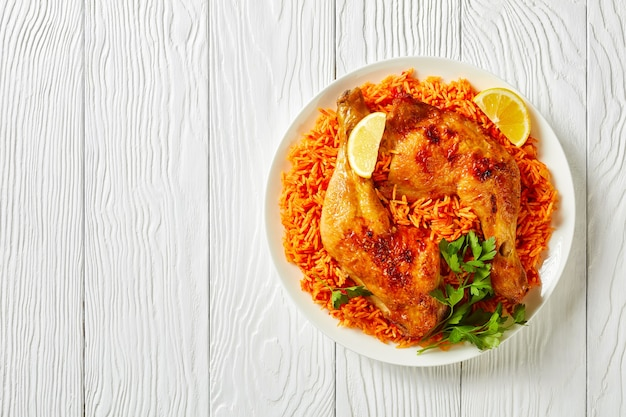 Indian tomato rice with roasted chicken quarters cooked of basmati rice with red chili powder, cinn