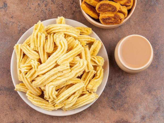 Indian traditional spicy snack ghatiya with bhakarwadi Premium Photo