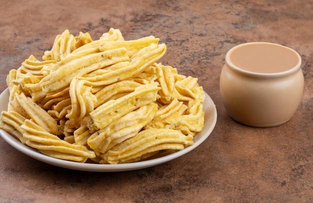 Indian traditional spicy snack ghatiya Premium Photo