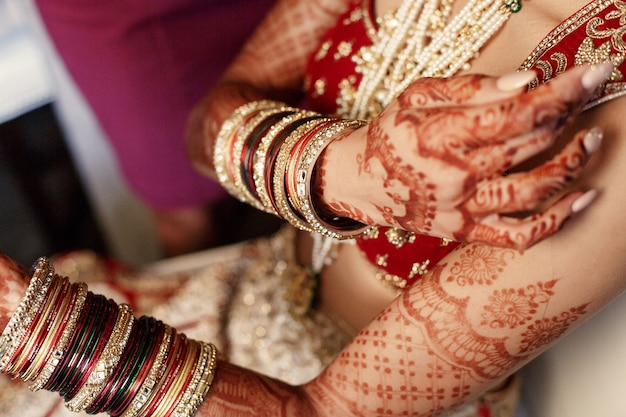 Mehndi Free Hand : Indian woman holds her hands covered with mehndi photo free download