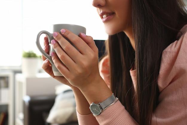 Indian woman holds mug her hand smiles Premium Photo