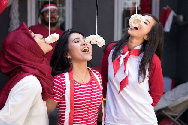 Indonesia crackers eating competition Premium Photo