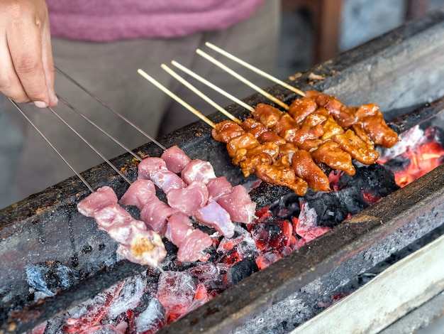 Indonesian food satay burned using charcoal Premium Photo