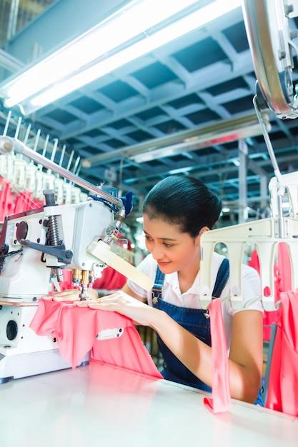 Indonesian seamstress in asian textile factory Premium Photo