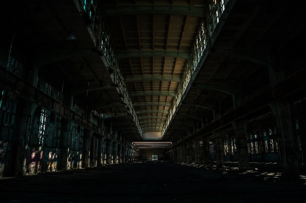 Indoors of an old large abandoned facility Free Photo