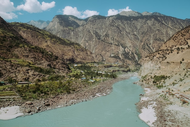 Indus river flowing through mountains in rural area of pakistan. view from karakoram highway. Premium Photo