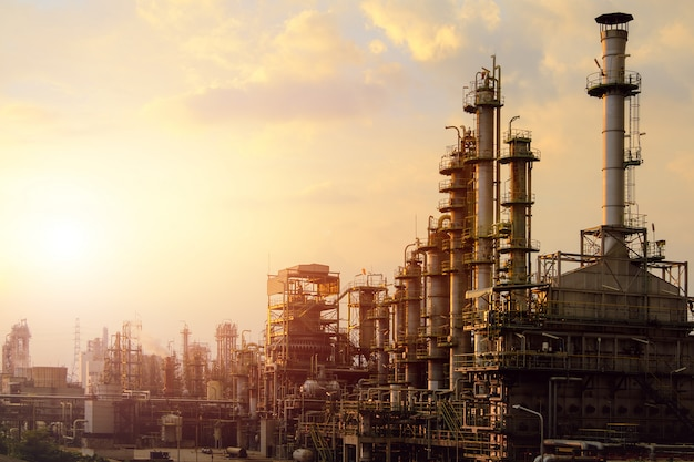 Industrial furnace cracked hydrocarbon in petrochemical business on sunset sky background, manufact