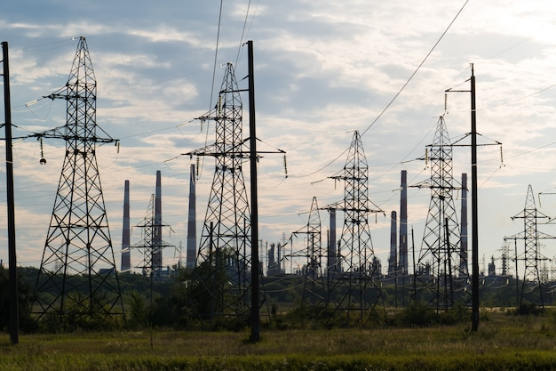 Industrial landscape with power lines in the background pipes refinery. Premium Photo