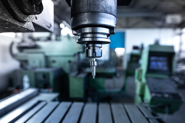 Industrial metal drill machine in metalworking workshop Free Photo