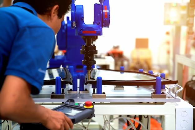 Industrial robot welding automotive part in car factory Premium Photo