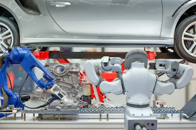 Industrial robotic working with auto parts for measuring data and maintenance Premium Photo