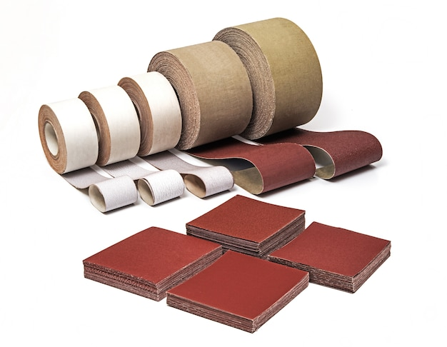 Industrial sanding belts, sand papers in rolls and sandpaper sheets Premium Photo