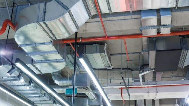 Industrial utilities under the ceiling. Premium Photo