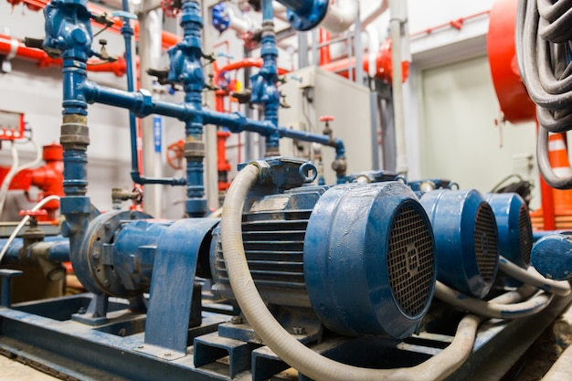 Industrial water pump and water pipes. Premium Photo