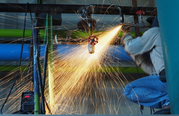 Industrial worker make a spark by grinding. Premium Photo