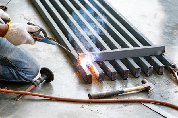 Industrial worker welding steel with sparks Premium Photo