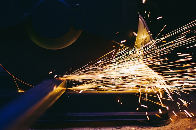 Industry electric fiber cutting steel with beautiful flash of sparks Premium Photo