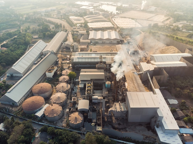 Industry factory manufacturing with emission smoke from chimneys Premium Photo
