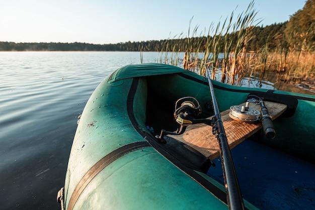 Inflatable boat on the lake at sunrise fishing hobby vacation Premium Photo