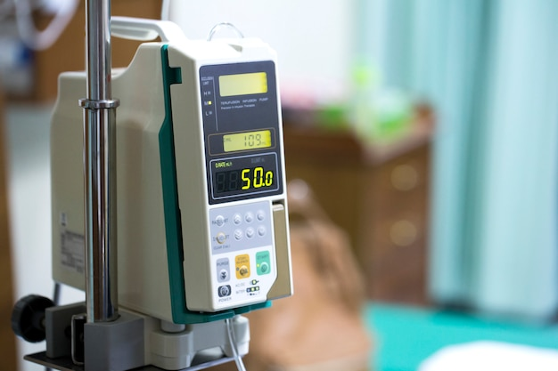 Infusion pump drip for patients in the hospital. Premium Photo