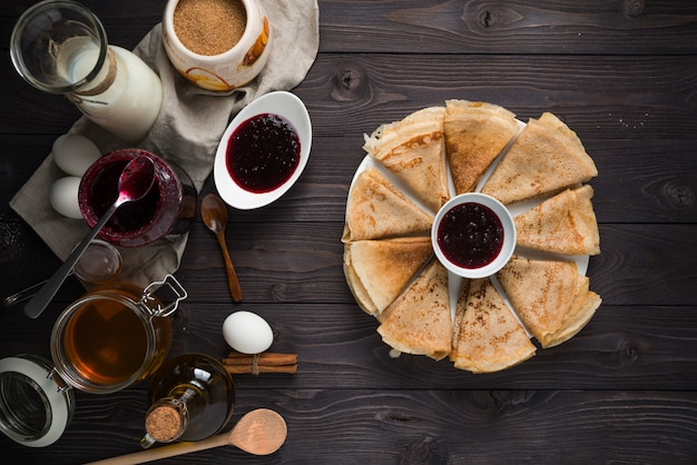 Ingredients for baking pancakes on a wooden table Premium Photo
