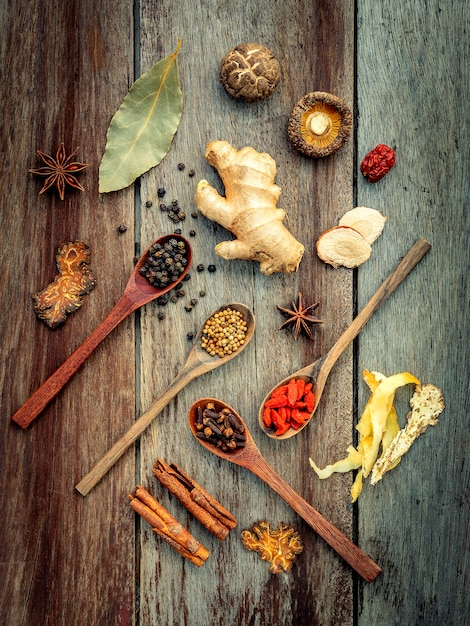 Ingredients for chinese herbal soup on shabby wooden background . Premium Photo