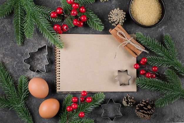 Ingredients for cooking christmas baking, white paper notebook Premium Photo
