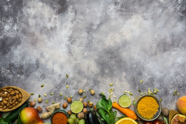 Ingredients for healthy cooking: vegetables, fruits, nuts, spices Premium Photo