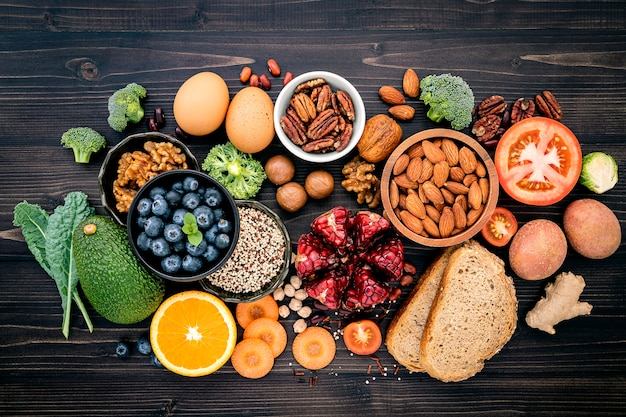 Ingredients for healthy food on wooden table Premium Photo