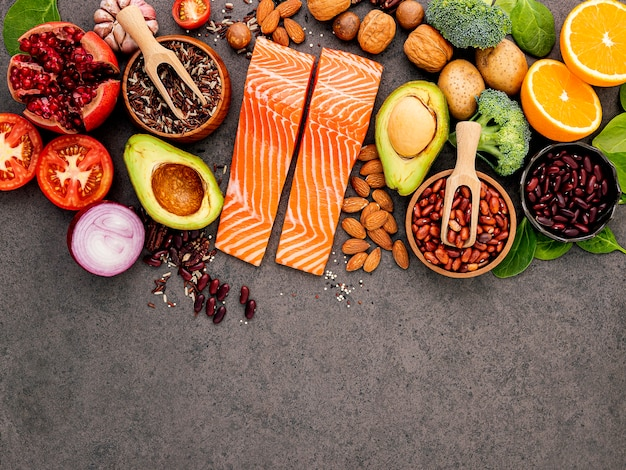Ingredients for the healthy foods selection on dark background. Premium Photo