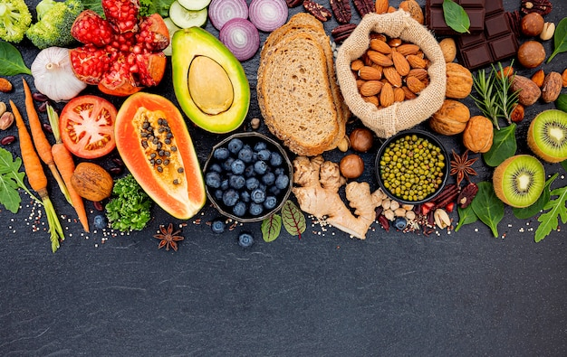 Premium Photo   Ingredients for the healthy foods selection set up on dark  stone background.