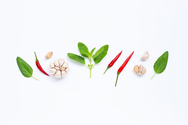 Ingredients herb and spice, holy basil, chili and garlic on white Premium Photo