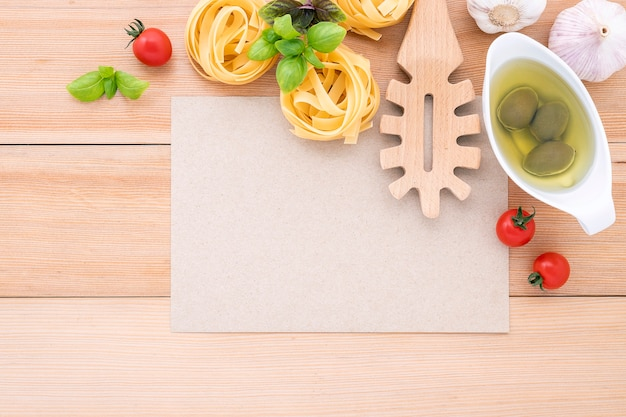 The ingredients for homemade pasta with copy space on wooden table. Premium Photo