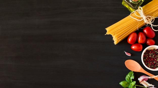 Ingredients for italian pasta on black background Free Photo