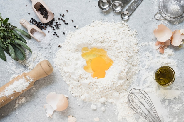 Ingredients for making dough for bread; cake on marble top Free Photo