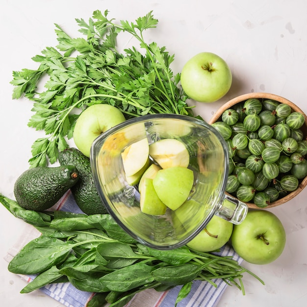 Ingredients for making healthy green smoothies Premium Photo