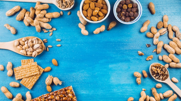 Ingredients for making homemade energy bar on blue textured background Free Photo