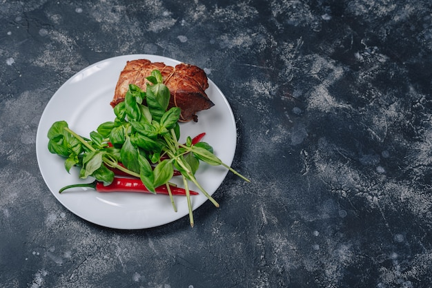 Ingredients on a plate on a dark concrete background Free Photo
