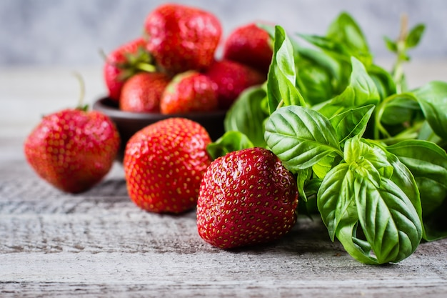 Ingredients for summer drink strawberry basil lemonade on concrete table background. close-up Premium Photo