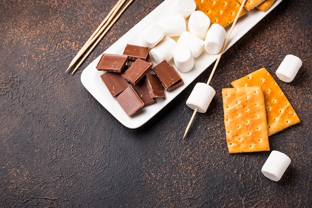 Ingredients for toasting marshmallows and cooking s'mores Premium Photo