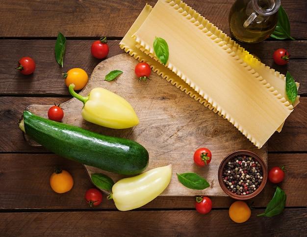 Ingredients for vegetarian lasagna. dietary menu. top view Premium Photo