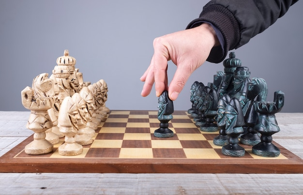 Initial movement of the peon in a chess game with pieces of collection Premium Photo