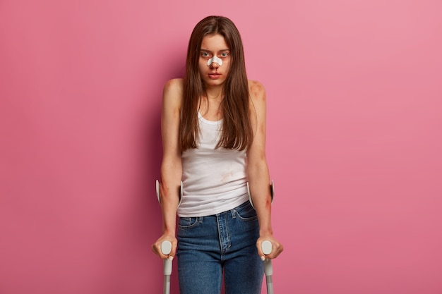 Injured woman recovers after accident with crutches isolated Free Photo