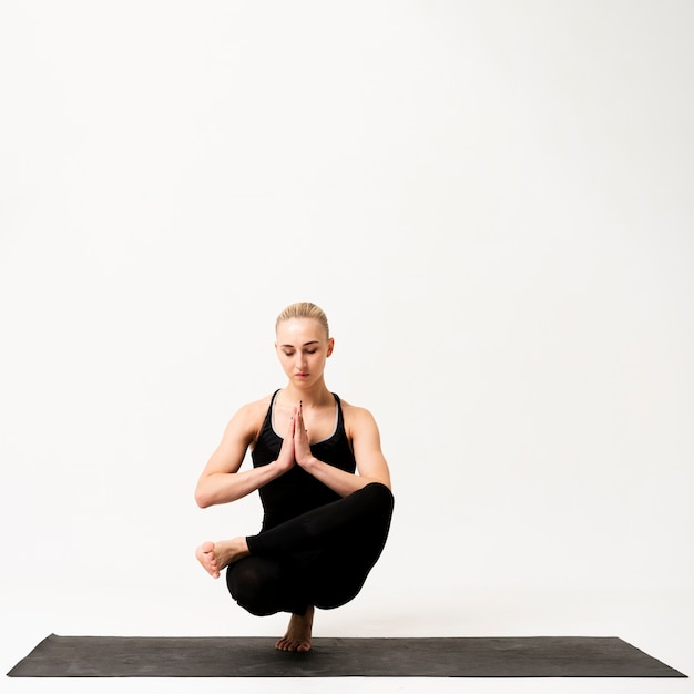 Inner balance while standing on one leg Free Photo