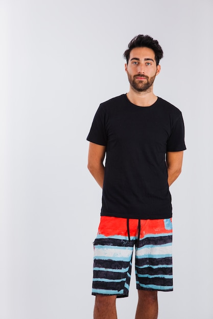 Innocent man in beachwear Free Photo
