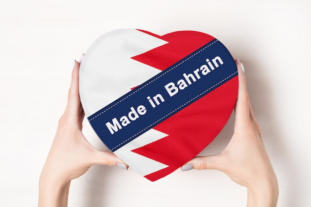 Inscription made in the bahrain flag with heart shape box Premium Photo