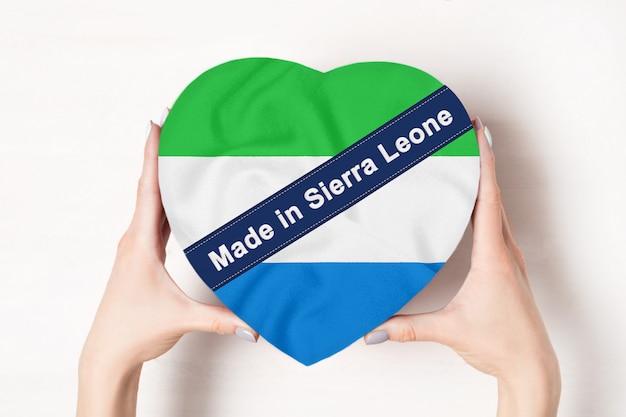 Inscription made in sierra leone flag with heart shape box Premium Photo
